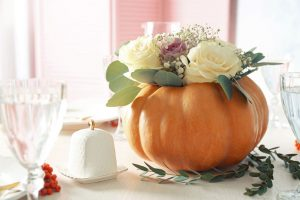 Seniors at Regency Birmingham assisted living can make fun and festive DIY crafts like this pumpkin floral arrangement to liven up the holidays.