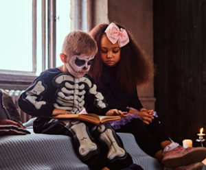 Halloween trends in the 40s included spooky skeleton costumes, fishnets, high heels, and heavy makeup.